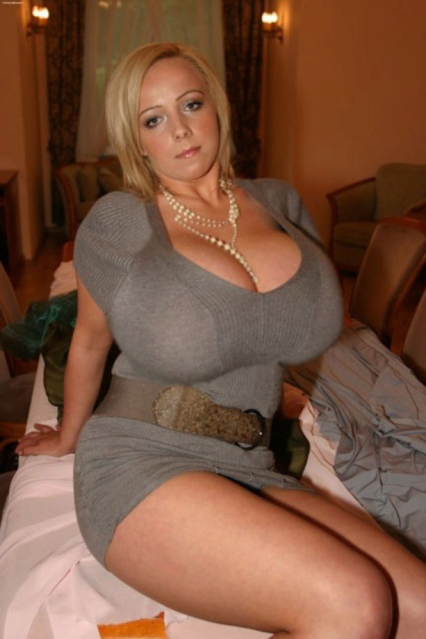 Mega busty blonde hottie teases with that cleavage