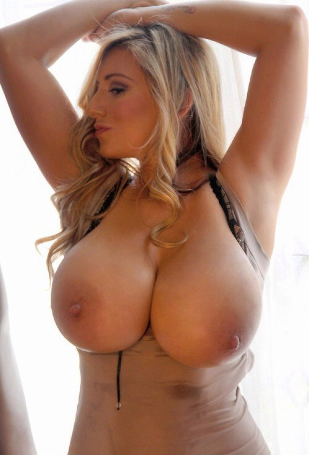 Ultra busty blonde show off her goods