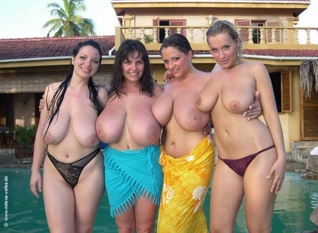 Four ultra busty babe are topless by the pool