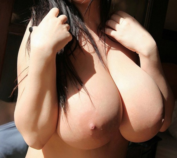 Brunette hottie presents her boobies in sunlight