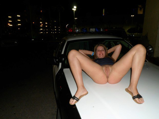 Sexy exhibitionist reveals twat on the bonnet of her car