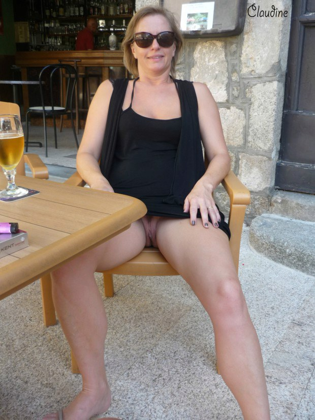 Mature wife with sunglasses shows upskirt in public