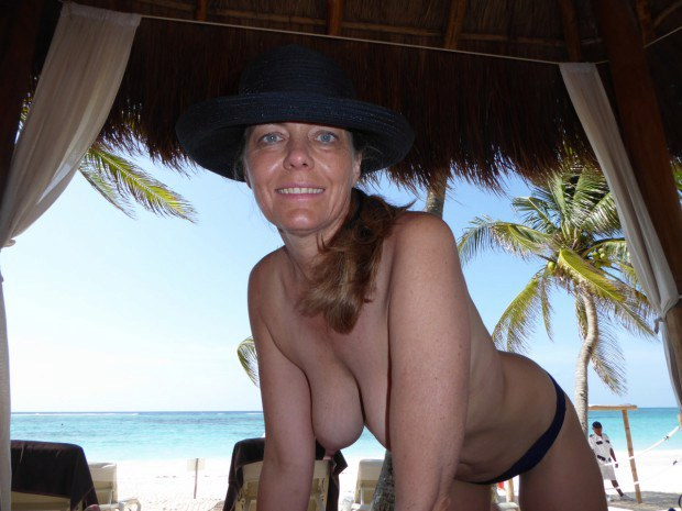 Blue eyed wife is topless on vacation