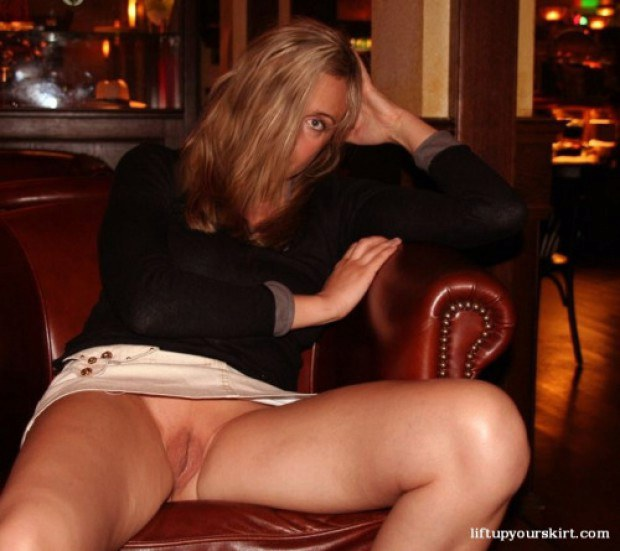 Blonde mature shows her twat in the restaurant