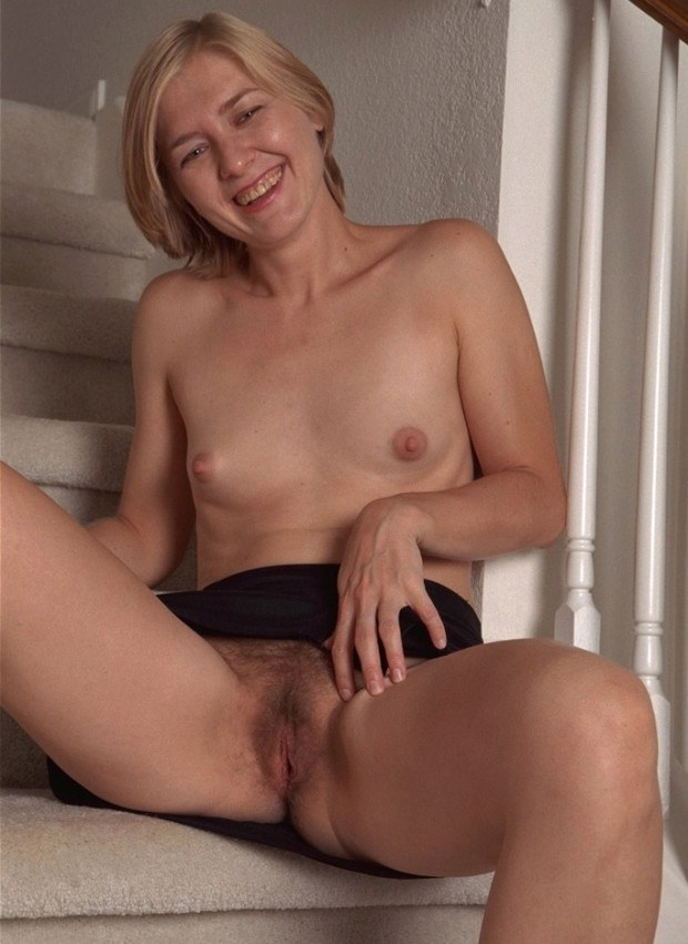 Small breasted MILF shows her nice body