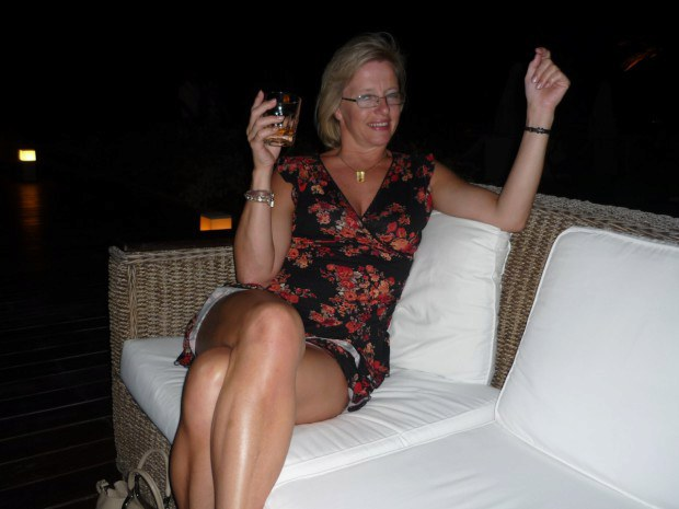 Mature with glasses shows upskirt while partying