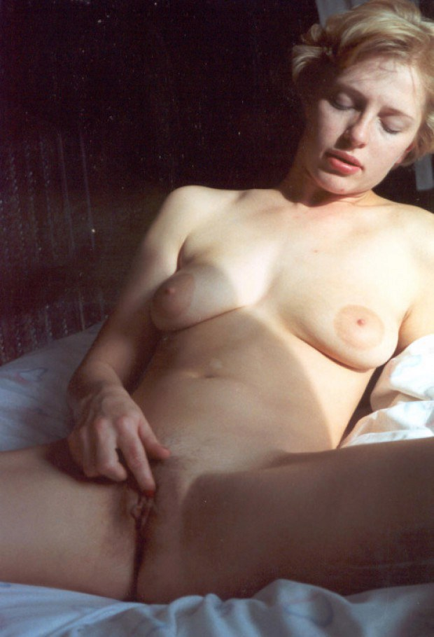 Busty wife Claudine fingers her pussy