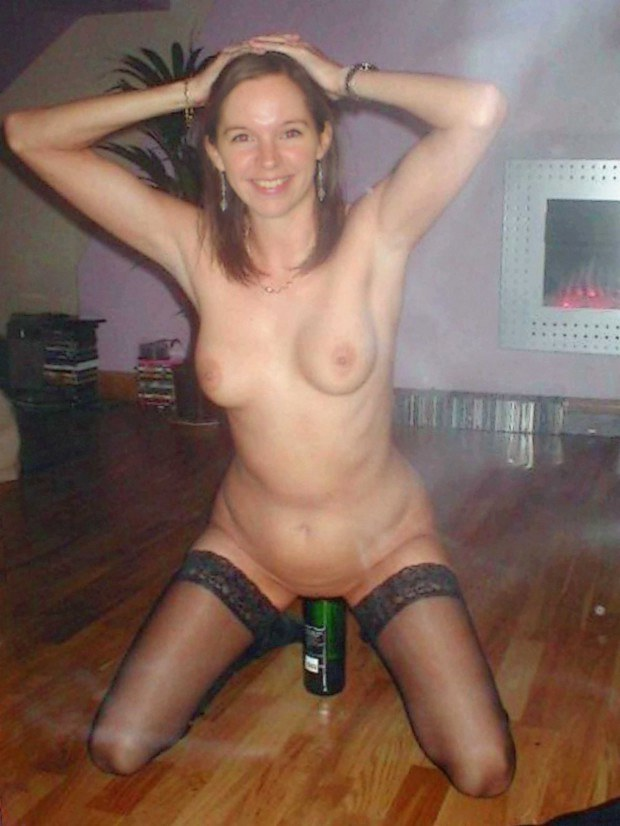 Amateur in stockings masturbates with a beer bottle