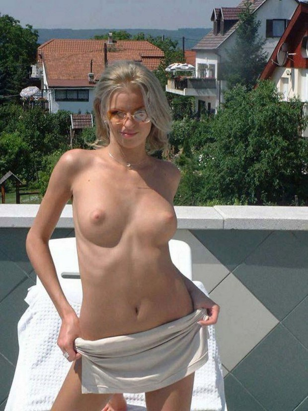 Blonde wife with sunglasses is topless on the roof