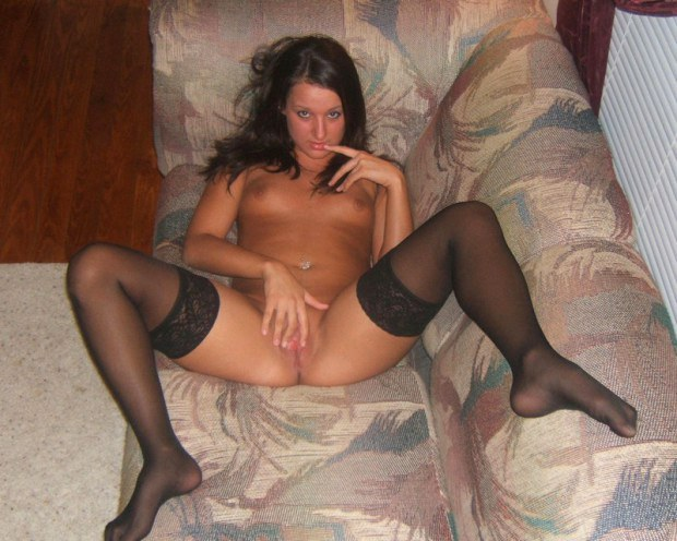 Girlfriend in stockings plays with her pussy