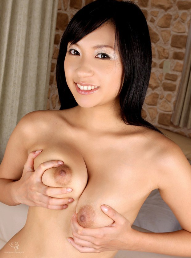 Lustful Asian babe squeezes her round titties