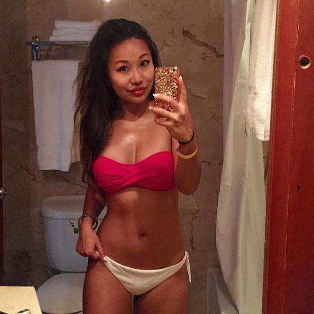Asian hottie takes a selfie in the mirror