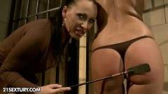 Busty mistress torturing her naked imprisoned slave