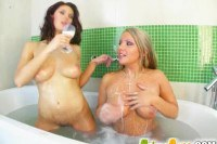 Busty lesbian couple taking a bath
