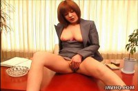 A redhead office chick has her cunt fingered